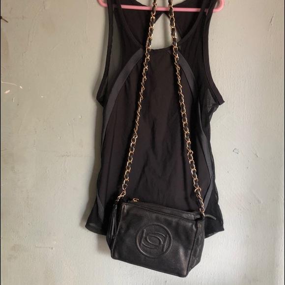 A nice black shirt w/ BeBe purse